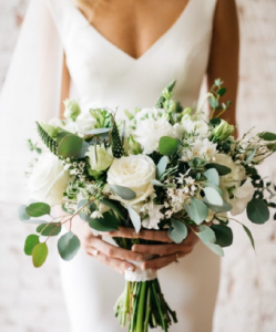Bride with wedding flowers natives
