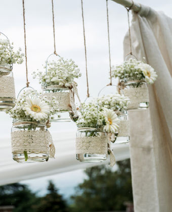 Flowers in glass jar hanging